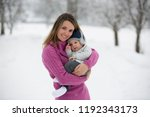 beautiful mother and cute baby... | Shutterstock . vector #1192343173
