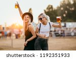 two female friends drinking... | Shutterstock . vector #1192351933
