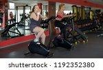 lazy corpulent woman eating bun ... | Shutterstock . vector #1192352380