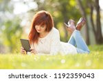 young woman with pad in the... | Shutterstock . vector #1192359043