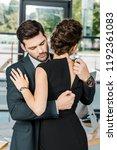young businessman unzipping...   Shutterstock . vector #1192361083