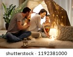 hygge and people concept  ... | Shutterstock . vector #1192381000