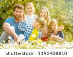 family of five sitting on a... | Shutterstock . vector #1192408810