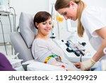 doctors assistant checking... | Shutterstock . vector #1192409929