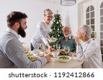 family gathered over for... | Shutterstock . vector #1192412866