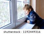happy adorable kid boy sitting... | Shutterstock . vector #1192449316