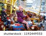 adorable little kid girl riding ... | Shutterstock . vector #1192449553