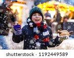 little cute kid boy eating... | Shutterstock . vector #1192449589