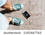 man drops his smartphone. look... | Shutterstock . vector #1192467763