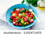 fresh bright tomato salad from... | Shutterstock . vector #1192471453