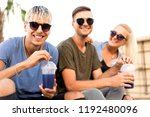 three friends on the beach... | Shutterstock . vector #1192480096