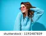 woman in blue sweater on blue...   Shutterstock . vector #1192487839