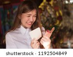 smiling excited asian woman... | Shutterstock . vector #1192504849