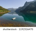 aerial view of a boat in a lake ... | Shutterstock . vector #1192526470