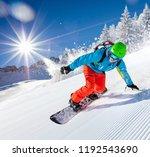 active man snowboarder riding... | Shutterstock . vector #1192543690