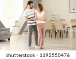 lovely couple dancing together... | Shutterstock . vector #1192550476