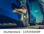 Truck Driver Concept. Driver Getting Into the Semi. Legs Closeup. - stock photo