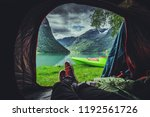 Scenic Tent Spot in the Norway. Glacial Lake and the Mountains. Norwegian Landscape. Waterfront Camping with Kayak. - stock photo