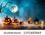 halloween pumpkins on dark... | Shutterstock . vector #1192685869