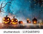 halloween pumpkins on dark... | Shutterstock . vector #1192685893