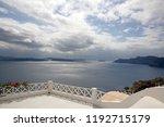 impressive view over santorin ...   Shutterstock . vector #1192715179