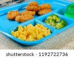 grade school lunch tray of... | Shutterstock . vector #1192722736