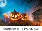 spooky halloween pumpkins in... | Shutterstock . vector #1192737460