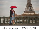 romantic couple in paris near... | Shutterstock . vector #1192742740