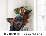 african black family spend time ... | Shutterstock . vector #1192766143