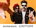 Stock photo wonderful couple in halloween costumes making selfie smiling lady in mexican attire celebrating 1192772599