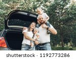 young couple with their little... | Shutterstock . vector #1192773286