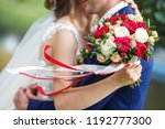 the bride put her hands on the... | Shutterstock . vector #1192777300