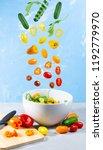 levitating mixed vegetables on... | Shutterstock . vector #1192779970