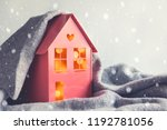 metal red model of a house with ... | Shutterstock . vector #1192781056