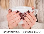 woman with brown nails polish... | Shutterstock . vector #1192811170