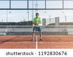 sportsman playing padel game | Shutterstock . vector #1192830676