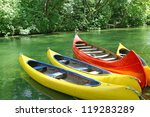 Four Empty Plastic Canoes In...