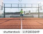 sportsman playing padel game | Shutterstock . vector #1192833649