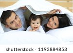 happy family posing under a... | Shutterstock . vector #1192884853