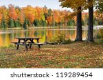 Stock photo autumn reflections on a calm pond and park alberta michigan usa 119289454