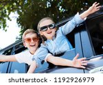 happy kids looking out the car... | Shutterstock . vector #1192926979