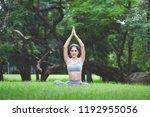 fitness asian woman doing yoga... | Shutterstock . vector #1192955056