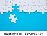 unfinished white jigsaw puzzle... | Shutterstock . vector #1192983439