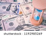 hourglass or sandglass on us... | Shutterstock . vector #1192985269