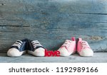 Stock photo cute tiny baby shoes on a wood with copy space for your text 1192989166