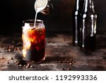 cold brew iced coffee in a... | Shutterstock . vector #1192993336