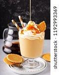 caramel coffee latte in a...   Shutterstock . vector #1192993369