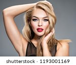 pretty girl posing at studio... | Shutterstock . vector #1193001169