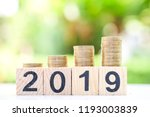 growth of coins stack on wood... | Shutterstock . vector #1193003839