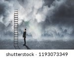 young businessman looking at...   Shutterstock . vector #1193073349